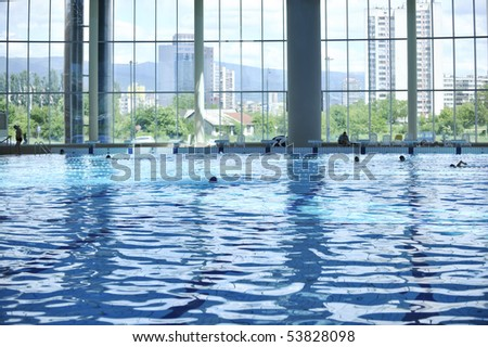 big olympic swimming pool indoor at day
