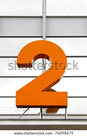 Big orange number two sign at building - stock photo