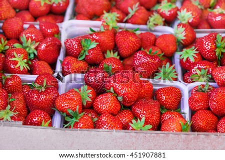 Big organic strawberry in baskets on the market. High resolution product.