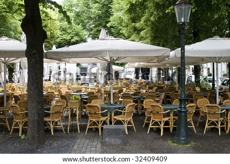 Big outdoor cafe in Europe - stock photo