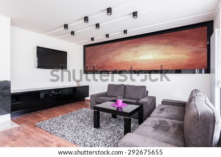 Big painting on the wall in elegant sitting room - stock photo