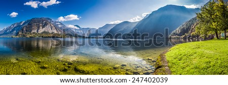 Big panorama of crystal clear mountain lake in Alps - stock photo
