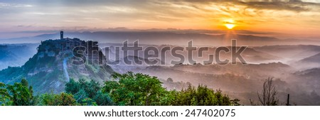 Big panorama of of Bagnoregio at dusk in Italy - stock photo