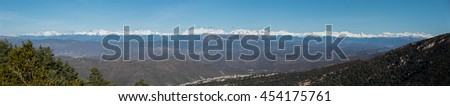 Big panorama of the Pyrenees mountains with snow at top of the range - stock photo