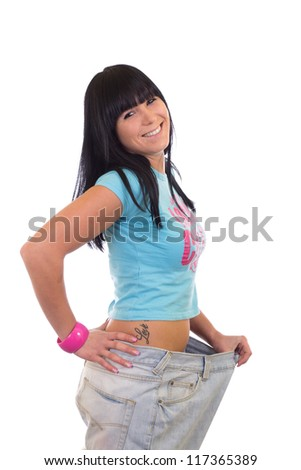 Big pants weight loss young woman - stock photo