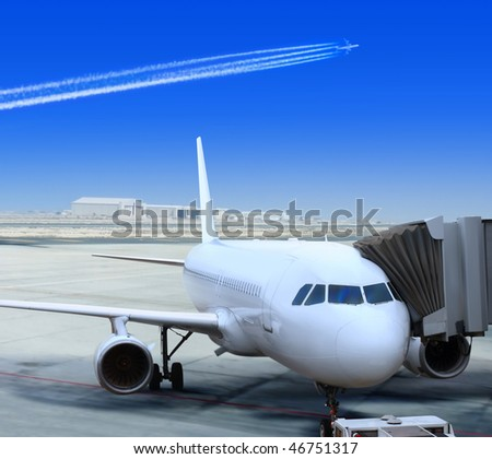 big passenger airplane is landing to runway of airport - stock photo