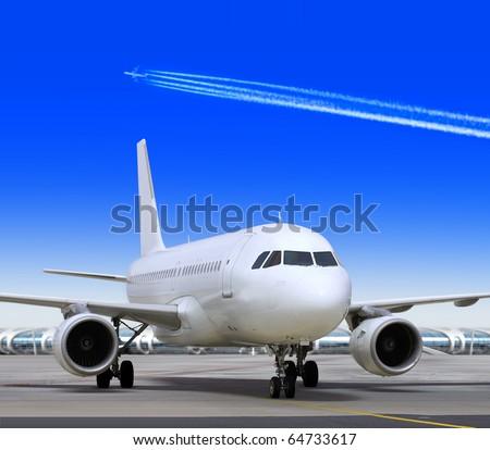big passenger airplane is landing to runway of airport - stock photo