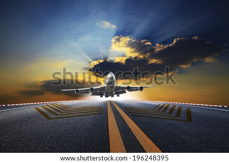 big passenger plane flying over airport runway against beautiful dusky sky use for air transport and traveling business  - stock photo