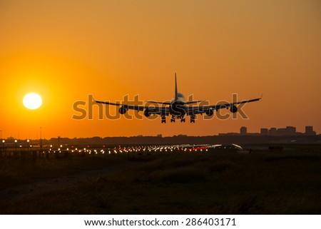 Big passenger plane started landing at the ground. - stock photo