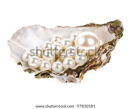 Big pearl in an oyster shell and small pearls , isolated on a white background .
