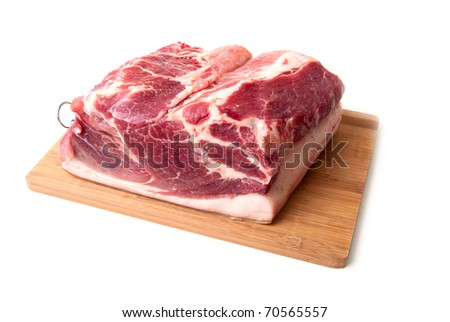 Big piece  meat on a kitchen board on a white background - stock photo