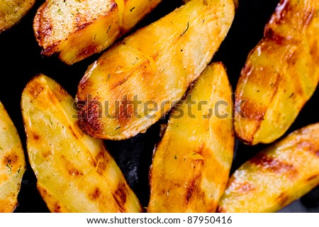 big pieces of grilled potatoes, macro