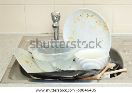 Big pile od dirty dishes - stock photo