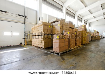 Big pile of boxes in distribution storehouse - stock photo