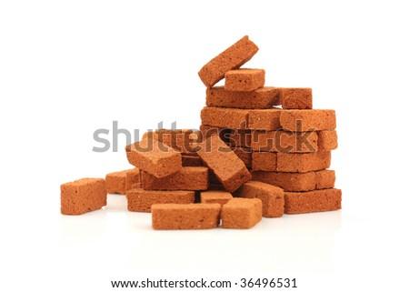 Big pile of bricks isolated - stock photo