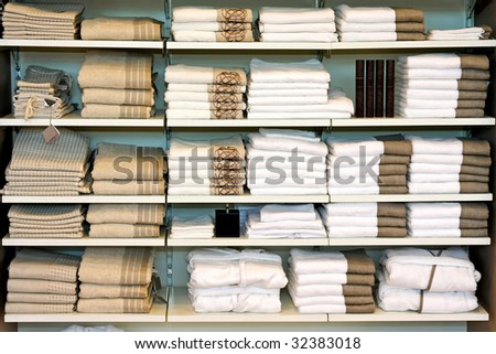 Big pile of cotton towels at shelf - stock photo