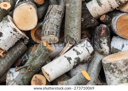 Big pile of firewood, fresh aspen and birch chocks lay outdoor - stock photo