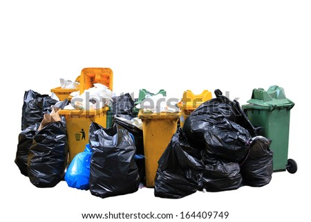 Big pile of garbage and waiste in black bags on white background - stock photo