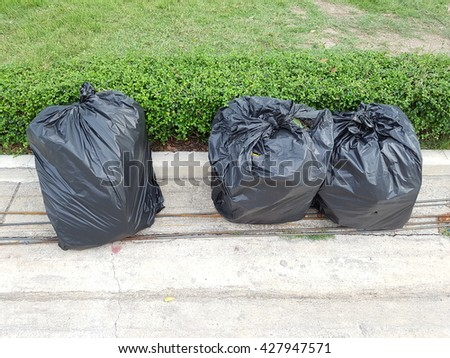 Big pile of garbage and waste in black bags - stock photo
