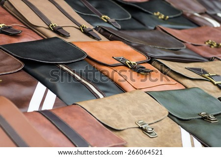 Big pile of leather bags - stock photo