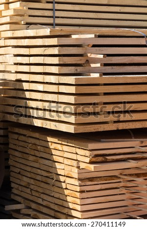 big pile of lumber, edge board for the construction site - stock photo