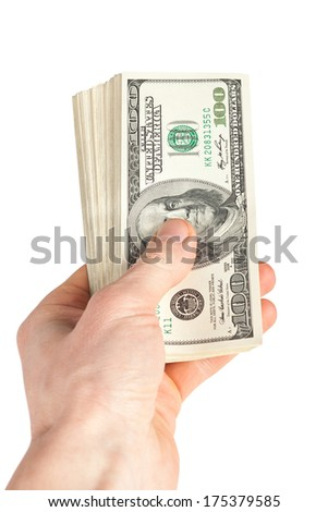 big pile of money (american dollars) in the hand