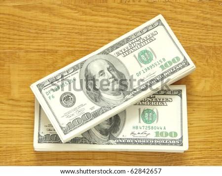 big pile of money over wood background - stock photo