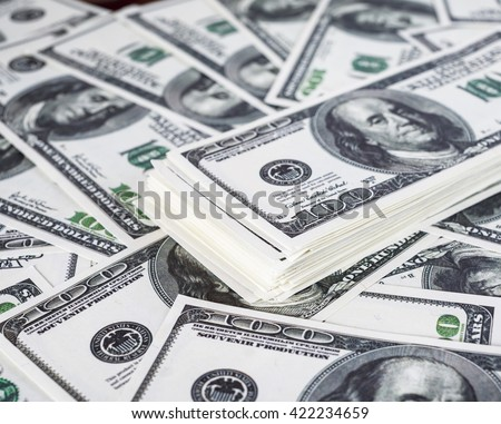 Big pile of money. Pile of one hundred dollar bills. Fake money. Money background. Business concept. Shallow depth of field. Selective focus. - stock photo