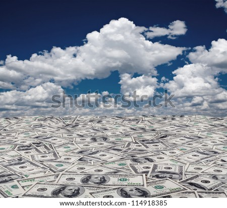 big pile of money. stack of american dollars on the sky backgrounds - stock photo
