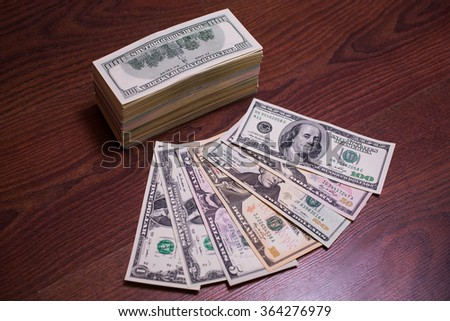 big pile of money. stack of money. money on the wooden background