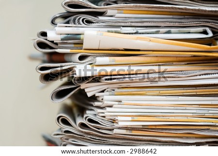 Big pile of newspapers, focus in front