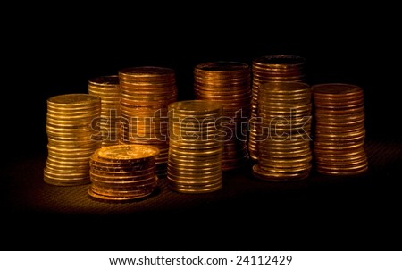 big pile shiny coins on a black background
