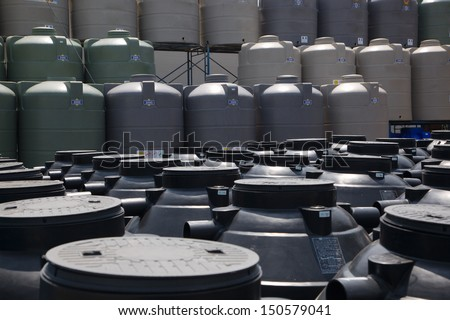 Big plastic container at warehouse. Used for accumulation, storage and transportation of not only technical or drinking water, but also for oils and chemicals. - stock photo