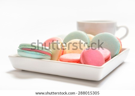 Big plate of colorful French macaroons in different flavors  - stock photo