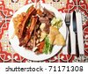 Big plate with assortment of foods - for really hungry guys - stock photo