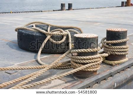 Big pontoon with bollard, tied in the harbor - stock photo