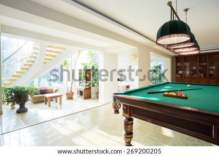 Big pool table in spacious living room - stock photo