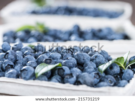 Big portion of fresh harvested Blueberries on wooden background (close-up shot) - stock photo