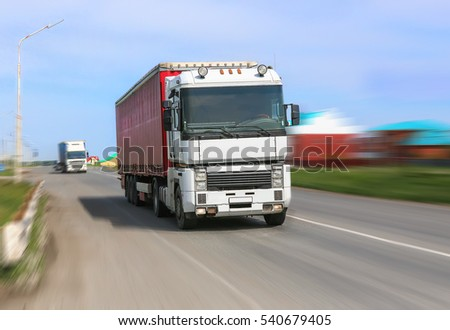 big powerful truck moves on highway