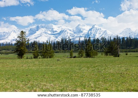Big Prairie in Glacier National Park and Mountains - stock photo
