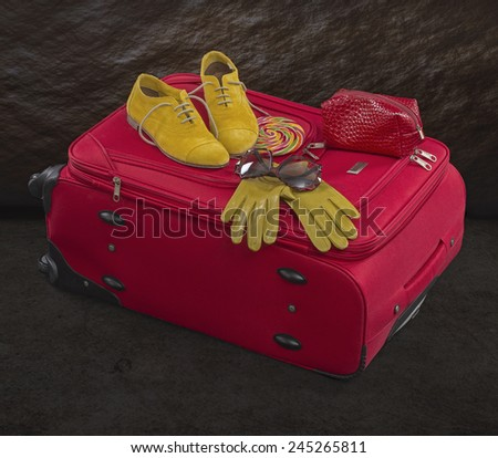 Big red bag in travel. - stock photo