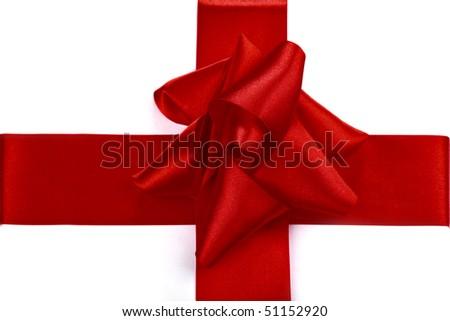 Big red celebrator satin ribbon tied in a bow - stock photo