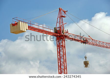 Big Red Construction Crane working in a site - stock photo