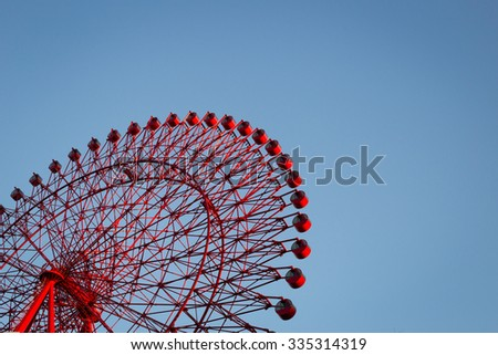 big red Ferris wheel and beautiful blue sky background - stock photo