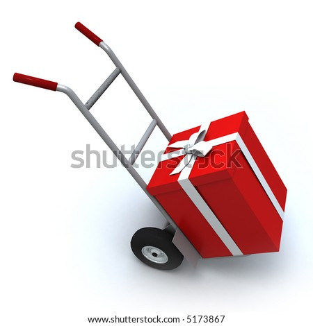 Big red gift box in a push cart - stock photo