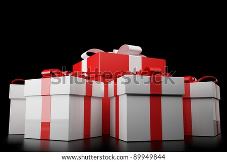 Big red gift box with withe gift box on black background - stock photo