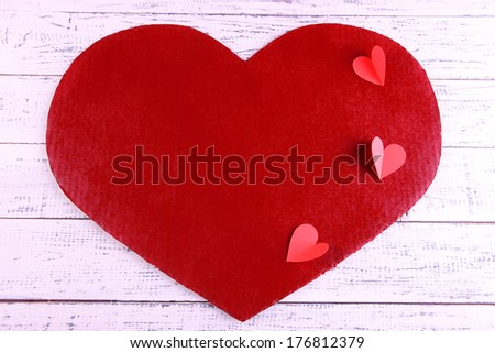Big red heart with small hears on wooden background - stock photo