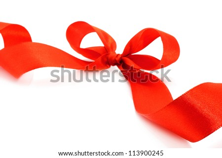 Big red holiday bow on white background - stock photo