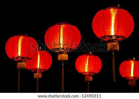 Big red lanterns will bring good luck and peace to prayer. It was at night in a chinese temple during Chinese New Year. - stock photo