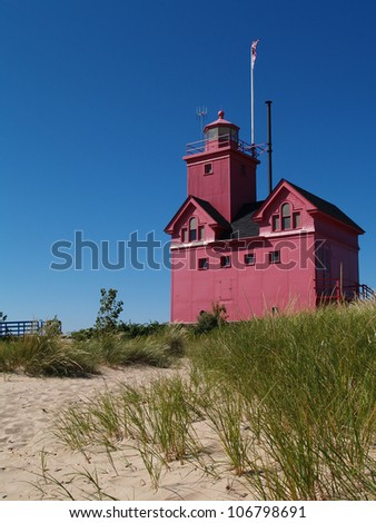 Big Red Lighthouse on the beach in Holland Michigan - stock photo